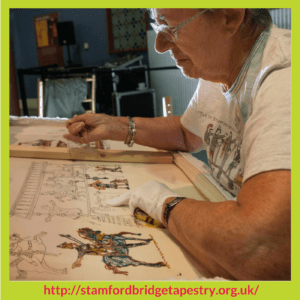 Doreen Savory working on the back of a panel Battle Of Stamford Bridge Tapestry – Stitchery Stories Podcast Episode